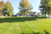 beautiful, spacious home on 6.59+/- unrestricted acres with pond, pool and outbuildings!