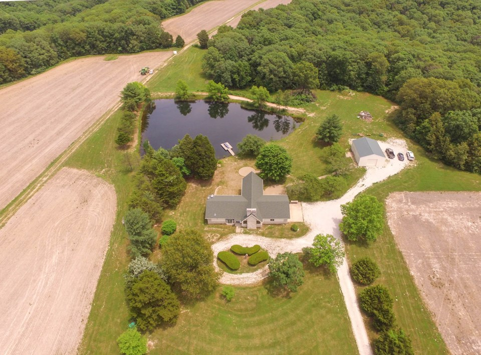 aerial of house and smaller lake.